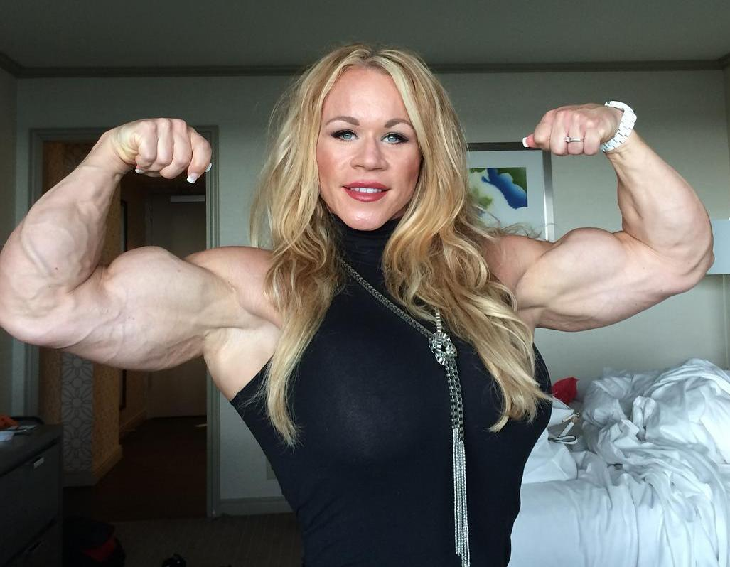 Busty lady bicep flex